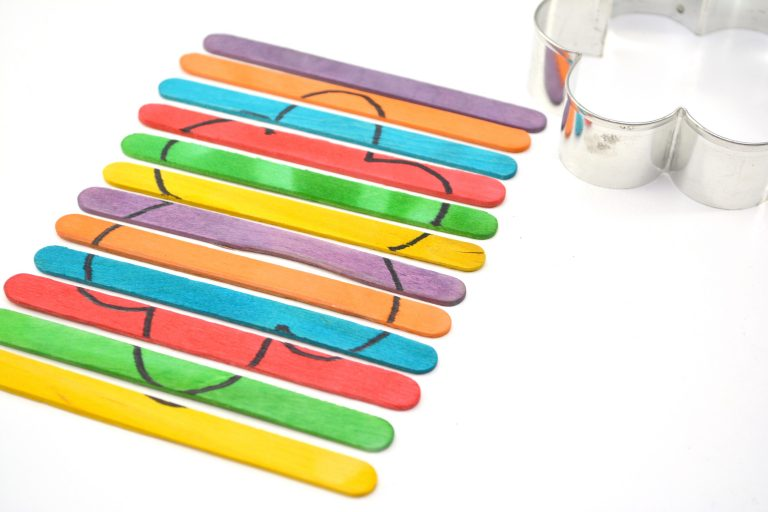 Easy Popsicle Stick Craft DIY Cookie Cutter Puzzle for Kids