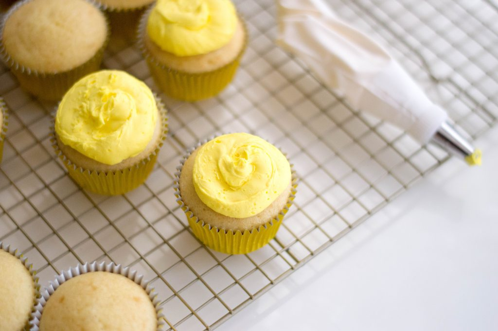 Yellow frosted cupcakes for Lego Cupcake Recipe
