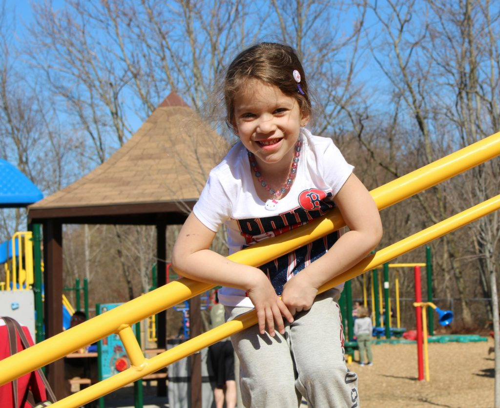 Girl at Inclusive Playground