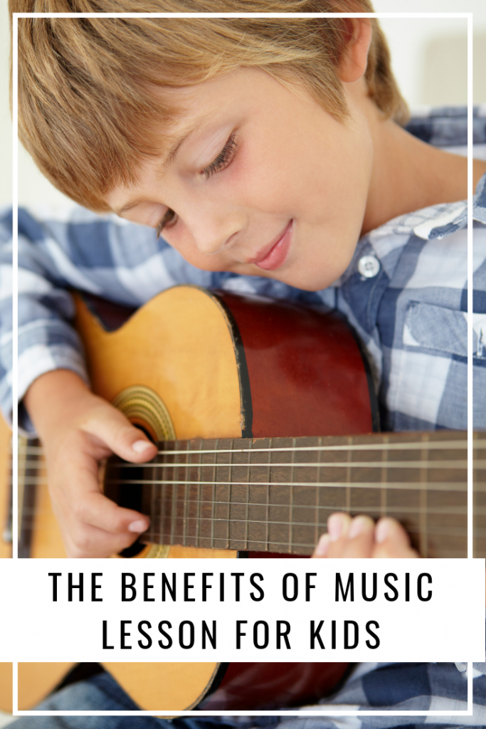 Boy playing guitar after music lessons