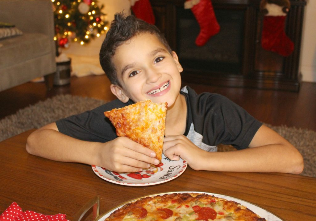 Boy eating Pizza for Pizza Night