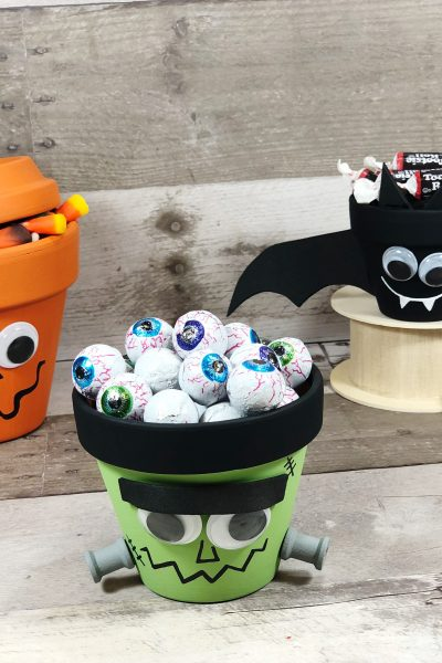 Clay pots made to look like halloween characters